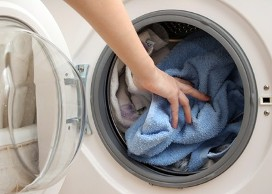 Person Doing Laundry, Laundry Leasing in Harlingen, TX